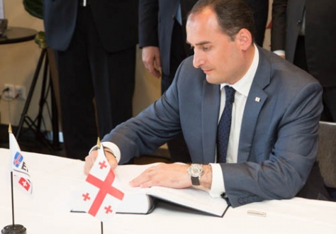 Mr Dimitry Kumsishvili, First Vice Prime Minister, Minister of Economy and Sustainable Development, signs the FTA on behalf of Georgia.